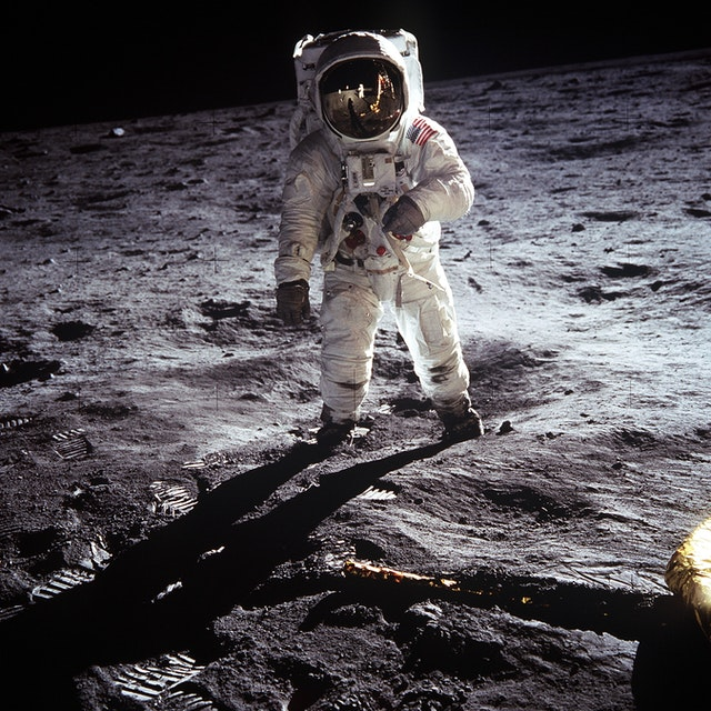 Person in Astronaut Suit on what looks like the Moon